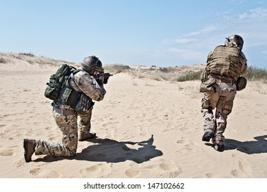 Two soldiers in the desert during the military operation