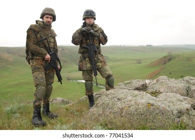 Two soldiers in heavy combative ammuniton on guard
