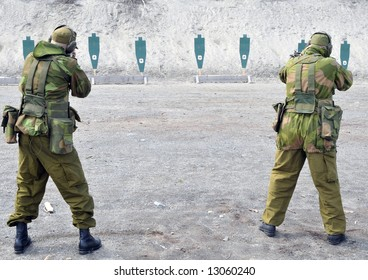 Two soldiers practicing shooting