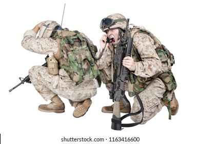 Two soldiers of special forces, marines team crouching to ground and radio communicating with command during battle, calling up reinforcements, reporting situation under enemy fire, isolated on white