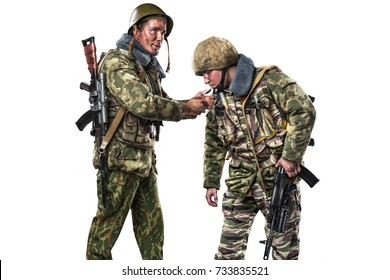 Two soldiers with weapons. Uniform conforms to Russian army special forces (OMON) in War in Chechnya. shot in studio. isolated with clipping path on white background