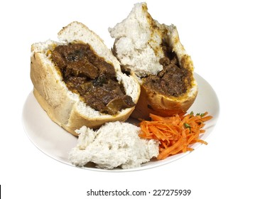 two south african mutton bunny chows with carrot and coriander sambal