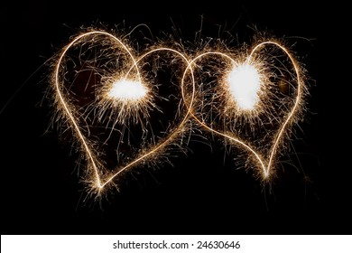 Two sparkling hearts isolated on black