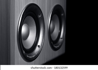 Two speaker systems on a black background