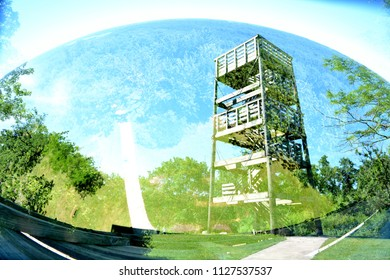 Two special effects in one photo.  The tower at Lapham park, and a fisheye view from the top of the tower double exposed to show the tower and the view from the tower.