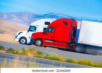 Two Speeding Semi Trucks on the Nevada Highway, USA. Trucking in America.