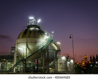 Two sphere gas storage in petrochemical plant at twilight