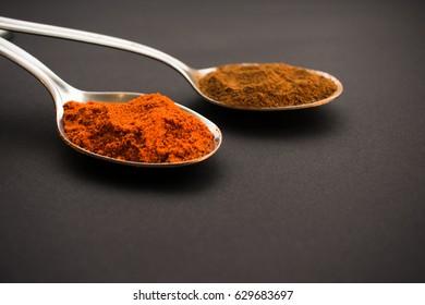 two spoons, spices,dark background, black, capsicum, ingredient
