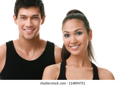Two sportive people in black sportswear, isolated on white