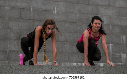 two sports gym girl working along at the sports ground, the concept of fitness and sports healthy lifestyle