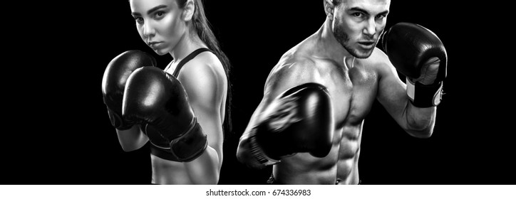 Two sportsmans boxers on black background. Copy Space. Sport concept.