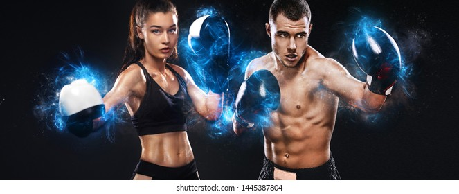 Two sportsmans, woman and man boxers fighting in gloves on black background. Boxing and fitness concept.