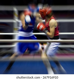 Two sportsmen boxing on a ring