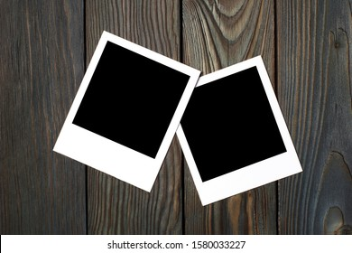 Two square blank photocards on dark wooden background