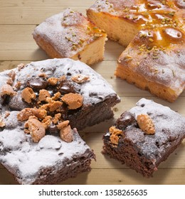 two square cakes cutted on wooden table, jam and chocolate flavor