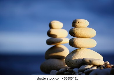 Two stack of pebbles against the blue sky