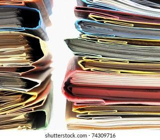 Two stacks of colorful folders over white background