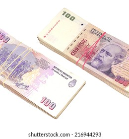 Two stacks of one hundred argentinean pesos banknotes isolated on white background.
