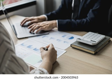 Two staff members of the finance department are sharing monthly financial statements together, they are working on a monthly summary report for their monthly meetings with management.