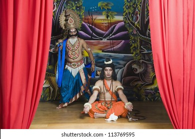 Two stage artists dressed-up as Rama and Ravana the Hindu mythological characters