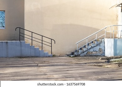 Two stairs against the wall of building