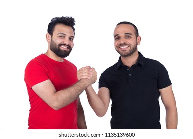 Two standing friends shaking hands strongly, isolated on a white background.