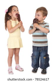 Two standing little children eating chocolate ice cream