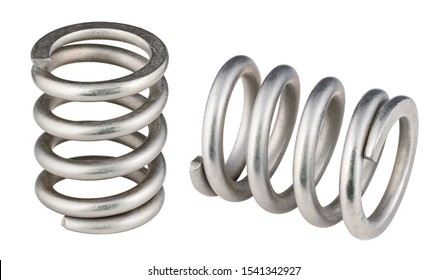 Two steel compression coil springs isolated on white background. Closeup of flexible shock absorbers with helical wire winding. Springy machine components. Elastic metal parts. Mechanical engineering.