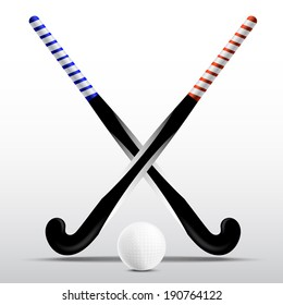 Two sticks for field hockey and ball on a white background