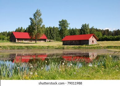 Two Stone Red Houses On The Pond