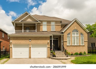 Two storey house with a lawn and driveway