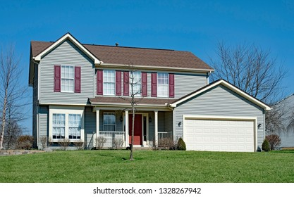 Two Story Gray House with Mauve Shutters