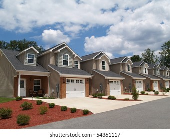 Two story low income retirement homes with the garage in the front.