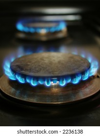 two stove blue flames burning