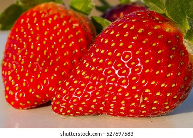 Two strawberries close up