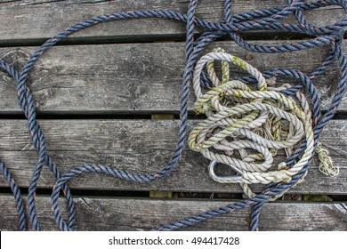 Two Strings Of Rope On Wooden Dock