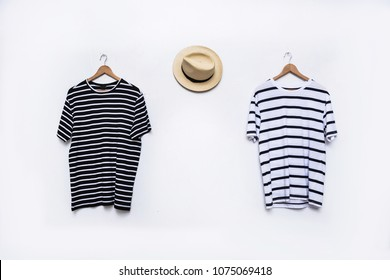 Two striped shirt with Panama hat on hanging-white background