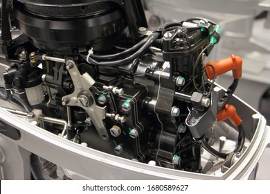 Two stroke outboard boat engine without bonnet close up