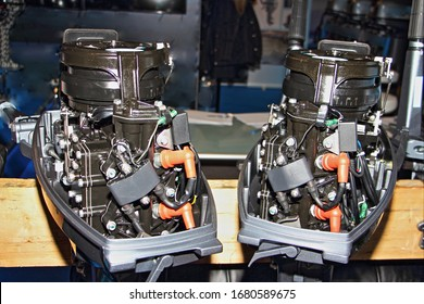 Two stroke tiller outboard boat motors without covers close up