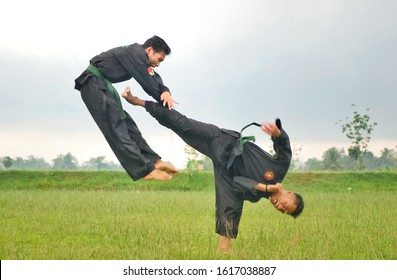 two student of pagar nusa are playing pencak silat in the field, purwokerto, central java indonesia 15 januari 2020