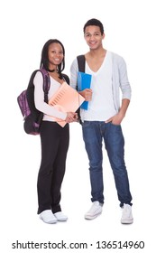 Two Students With Folder And Backpack Isolated Over White Background