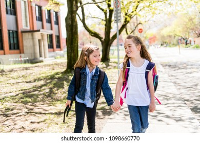 Two students outside at school standing together