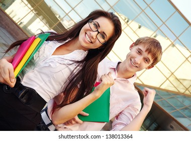 Two students showing success near school