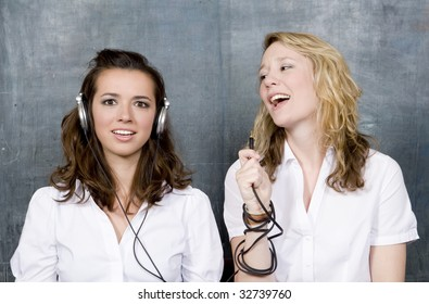 two students sit side by side, one listening while the other communicates