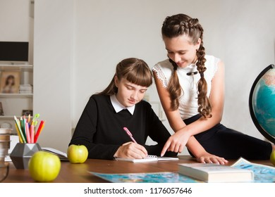 Two of students working together at the table