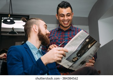 Two stylish men in the barber shop to discuss the latest football news
