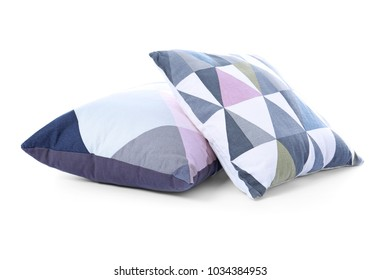 Two stylish pillows on white background