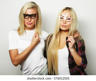 two stylish sexy girls best friends ready for party, over white background