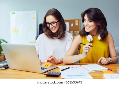 Two Successful business women collaborating in office