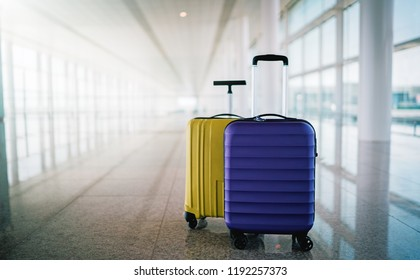 Two suitcases in empty airport hall, traveller cases in departure airport terminal waiting area, vacation concept, blank space for text message or design
